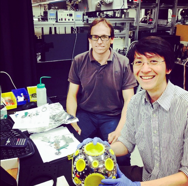 Edbert Jarvis Sie (right) and Timm Rohwer (left) in the Gedik research group with the diagnostic chamber from their time-resolved XUV ARPES setup.